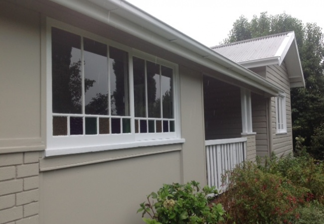 Pressure washing, sanding and painting to bring a fresh look to older homes.